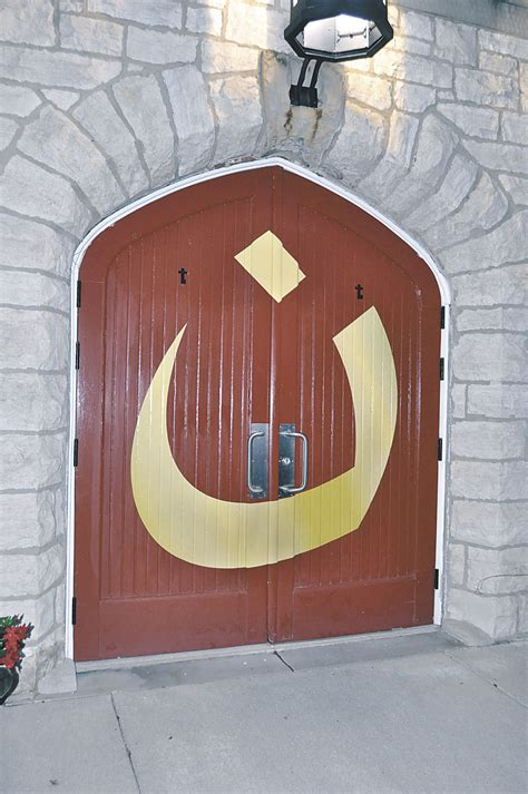 Arabic letter N painted on church door | Local News