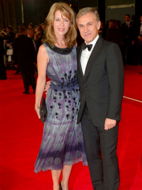 Judith Holste and Christoph Waltz walk the red carpet